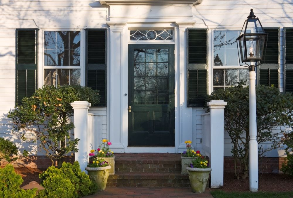 Close up photo of entry way of Cape Cod-style house