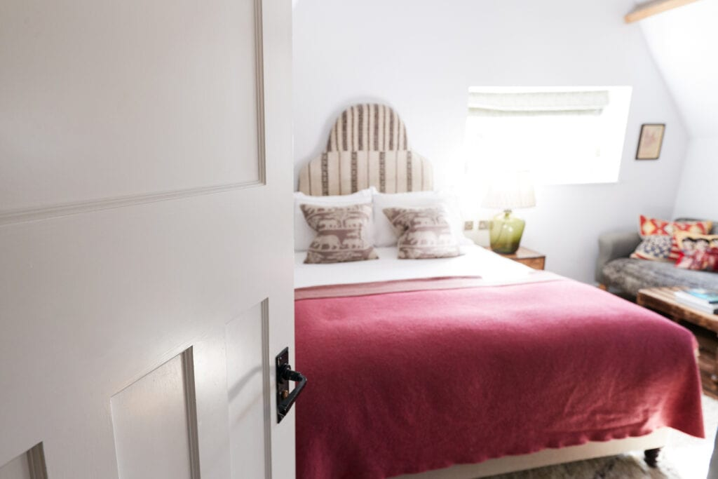 guest bedroom red blanket