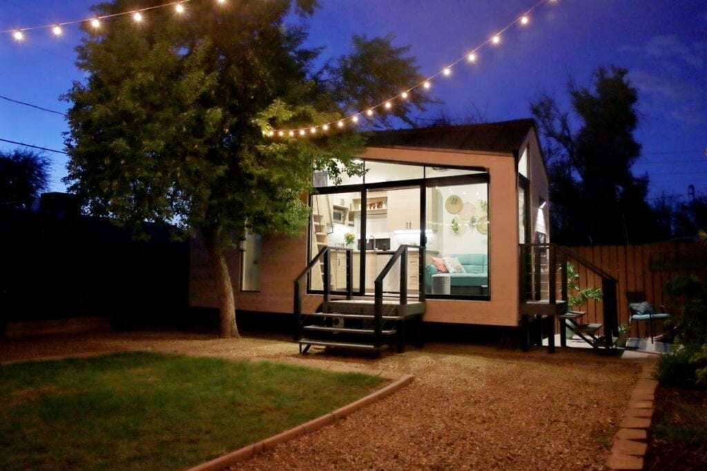 Tiny house with living room visible through windows