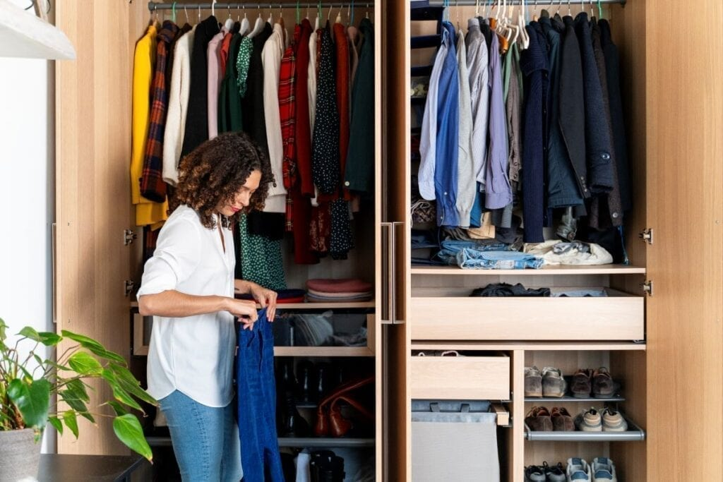 Woman organizing clothes in the closet