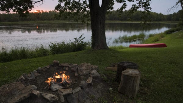 Canoe and Campfire by the River