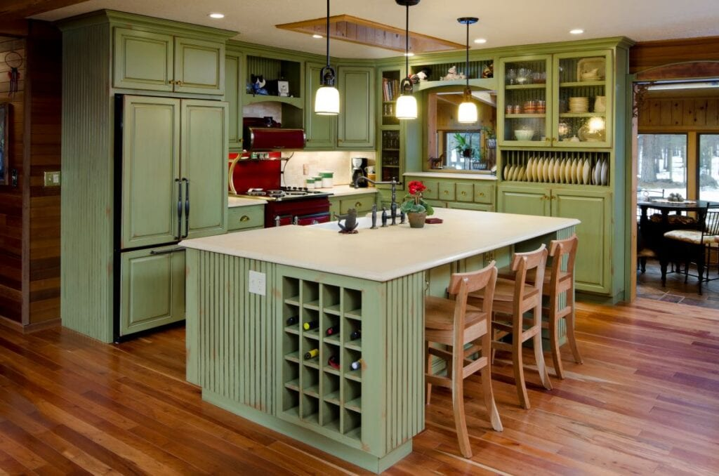Kitchen with green cabinets and island, built in wine shelves