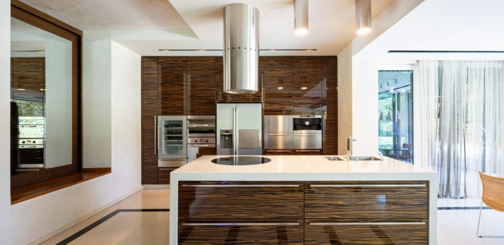Modern kitchen in wood and marble with wine refrigerator built in