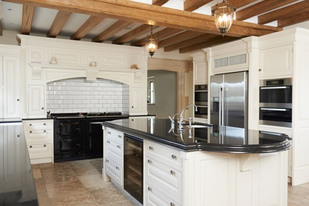 Luxury modern farmhouse kitchen with wine fridge built into island