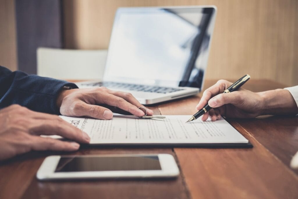 Person signing lease agreement with landlord