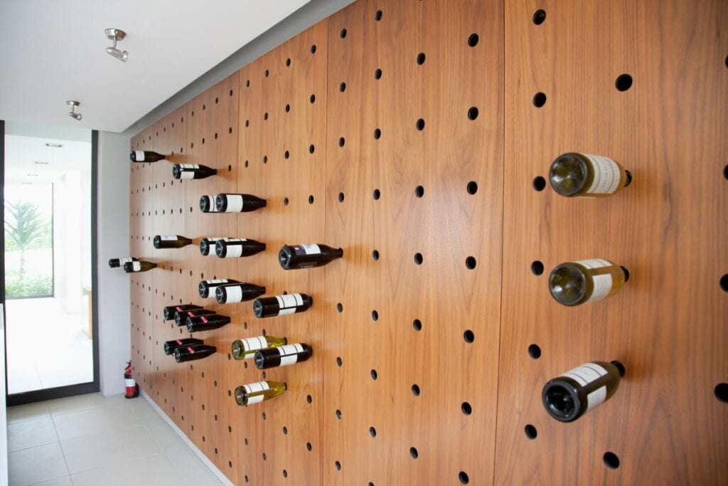Wine rack is built into wall like a pegboard in a modern home