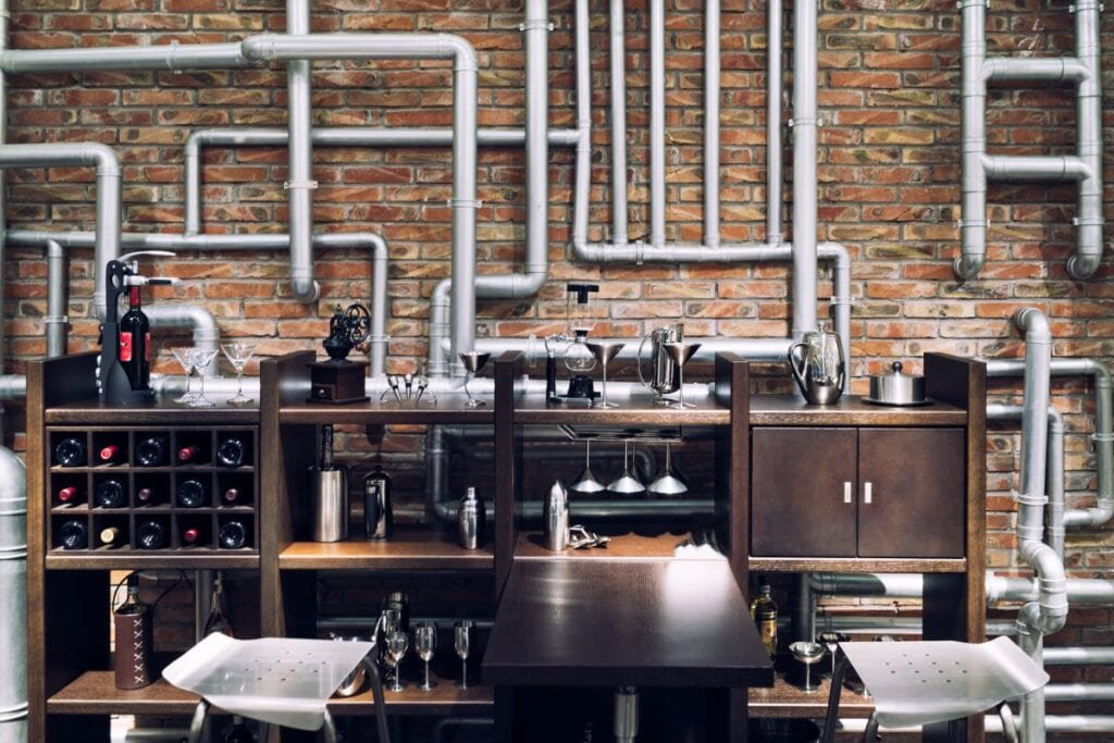 Industrial wine tasting room with wine storage and bar table
