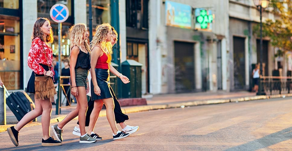 Young women explore the walkability of their new neighborhood.