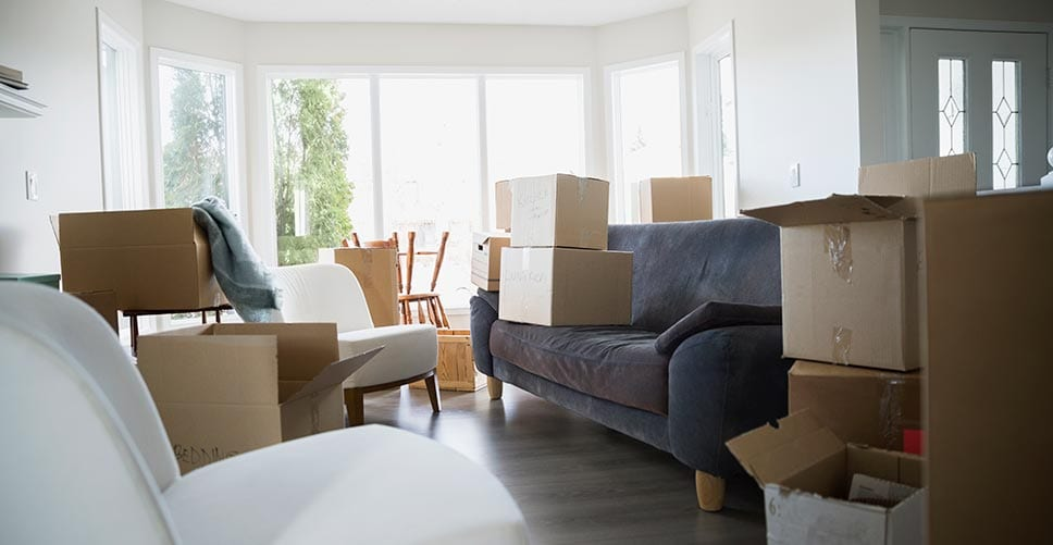 A half-packed living room with boxes that are ready for the moving company
