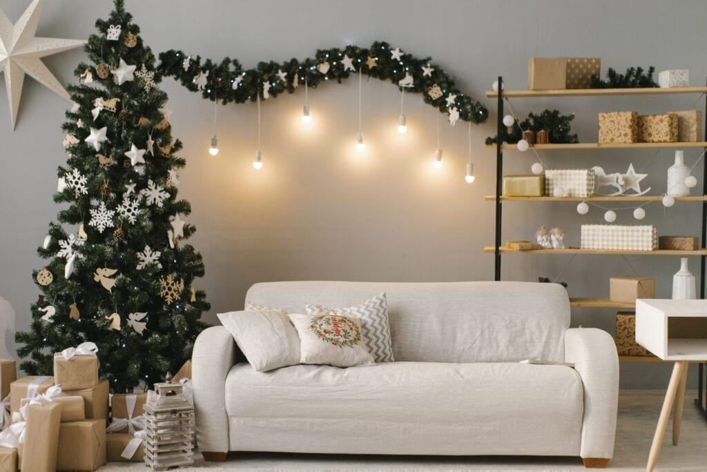 Christmas interior with bright sofa and Christmas tree