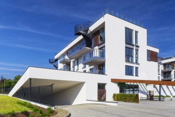 New white modern apartment building with underground garage
