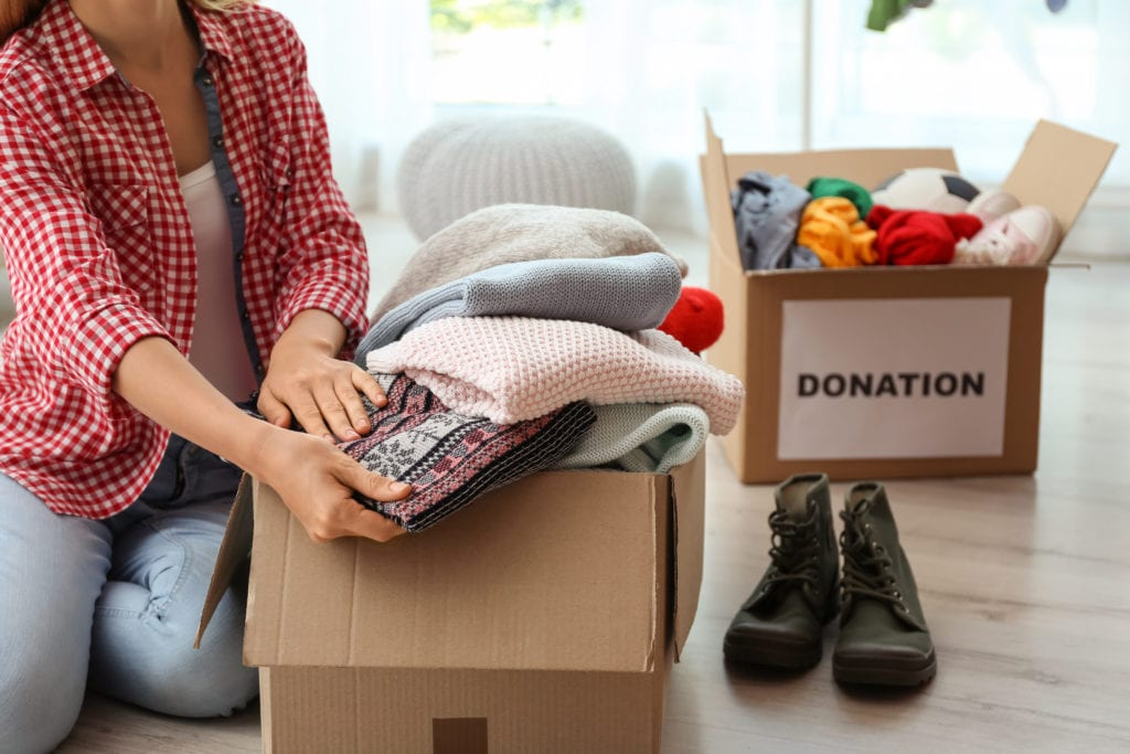 Woman packing items in donation box