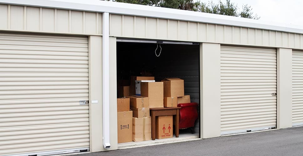 An open medium-sized storage unit filled with boxes.