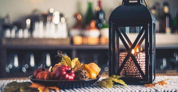 A farmhouse style table is decorated to convey the feeling of fall.