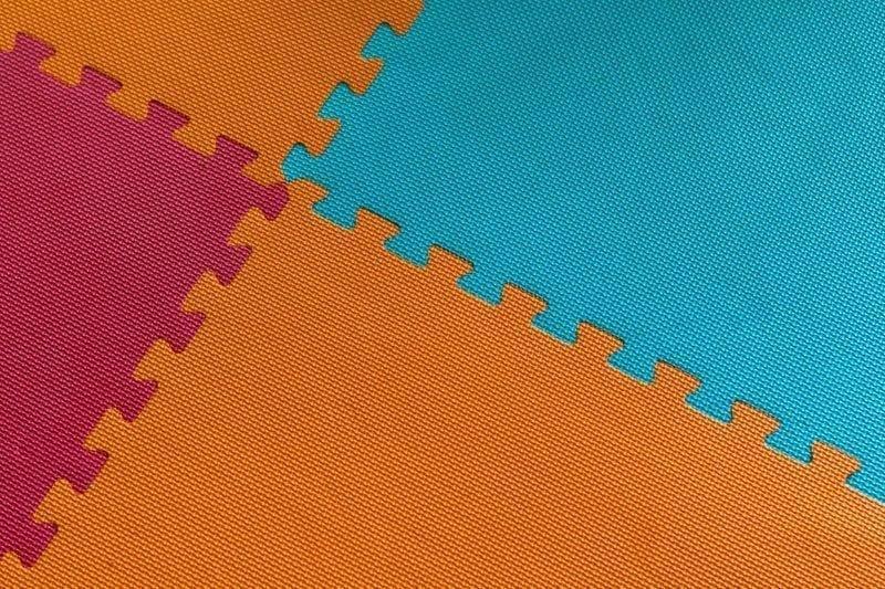 Colorful interlocking playroom floor tile