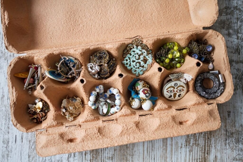 Jewelry organized in recycled egg carton to pack it for a move