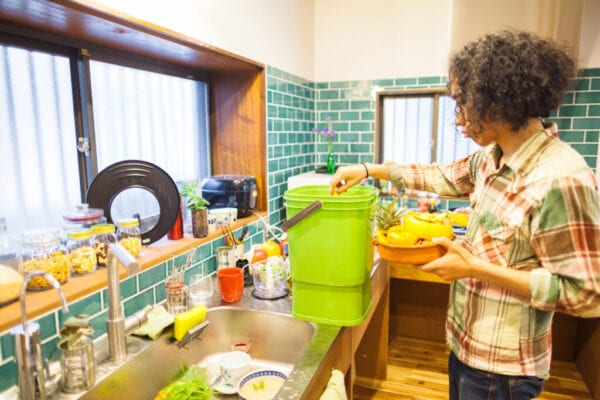 Man putting food left over into composter
