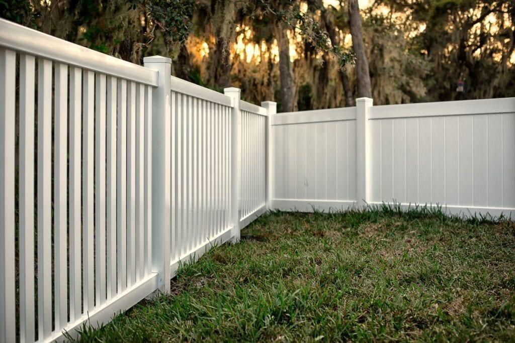 White vinyl privacy fence in backyard