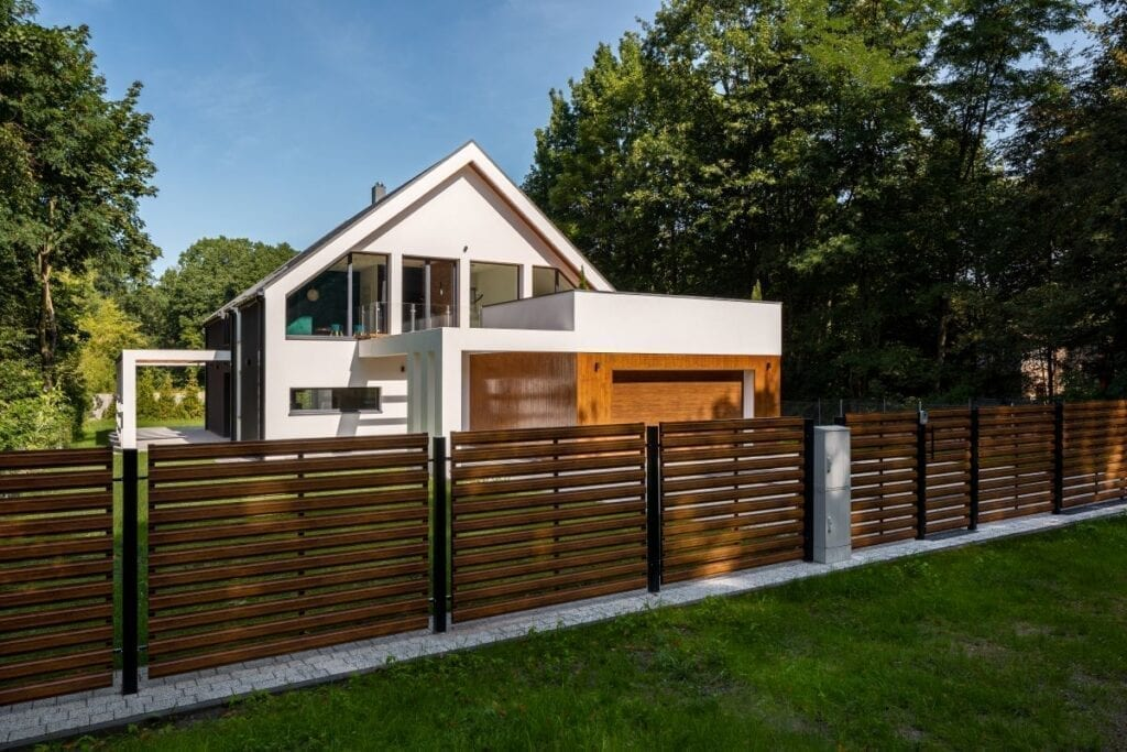 Wood and metal fence outside of modern house
