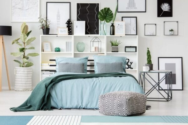 Bedroom with black, white, and blue colors for contrast