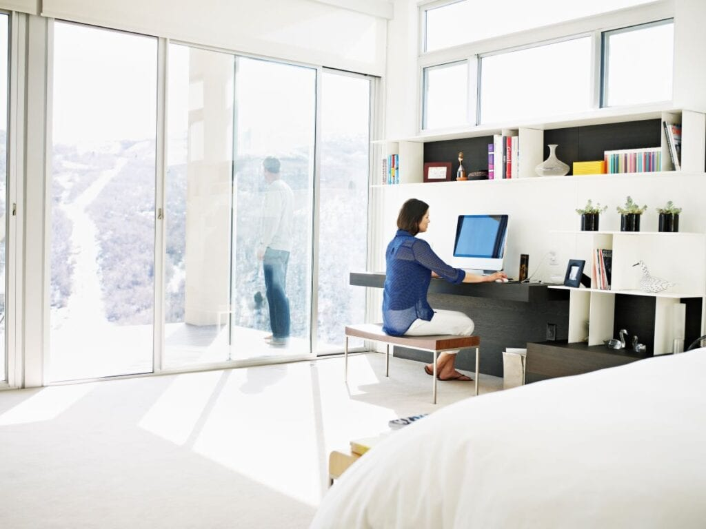 Woman working at floating desk in bedroom
