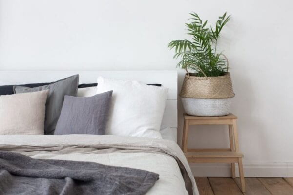 Modern bedroom with stool used for nightstand