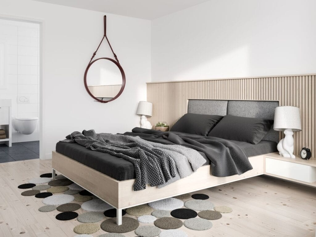 Modern minimalist bedroom with hanging wall mirror and floating night stands