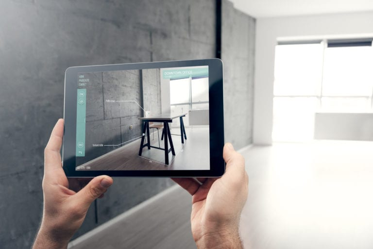 Person using augmented reality room design app to plan their home design