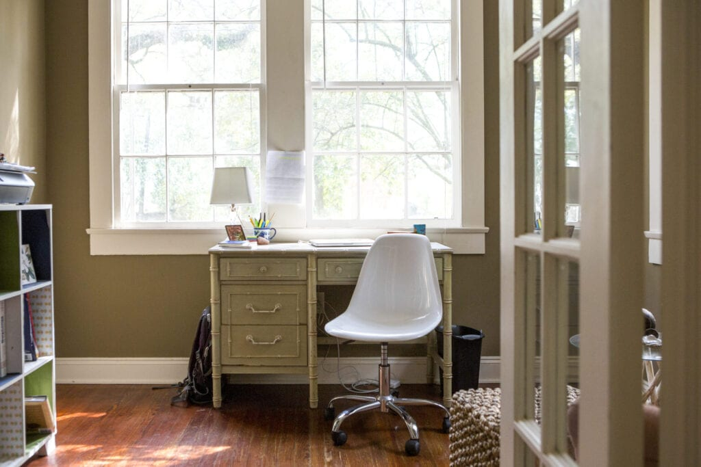 Small home office desk in light filled space.