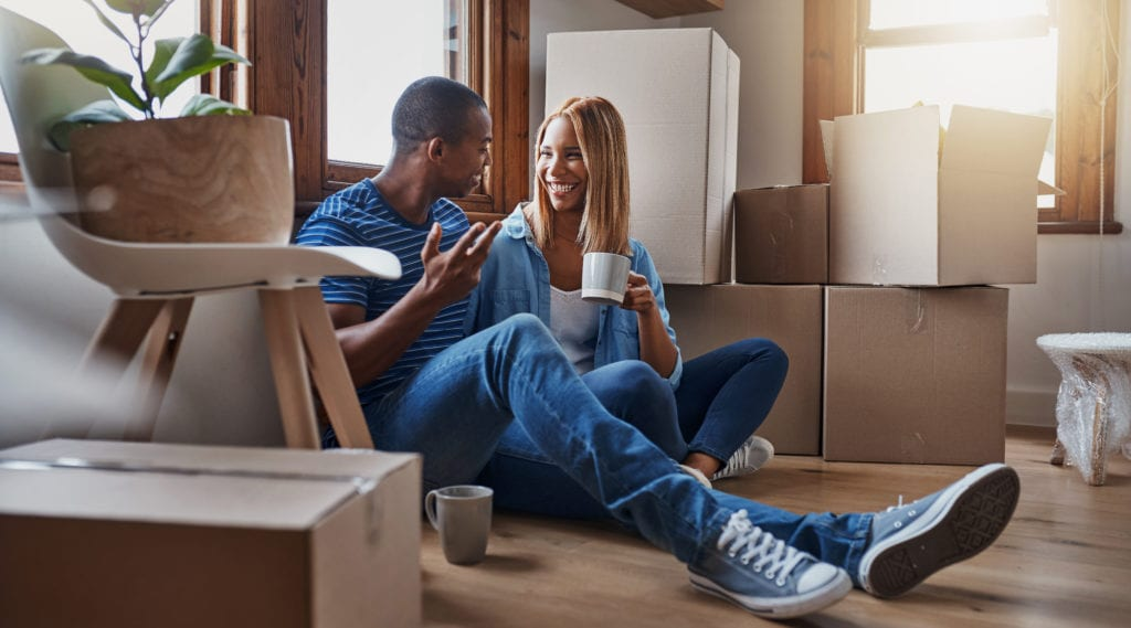 Two young first-time homebuyers settling into their new home