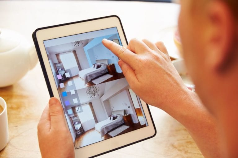Virtual room designer on ipad, person using room design software