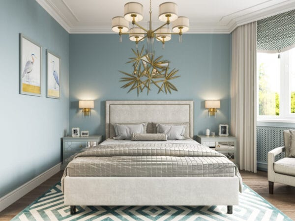 Luxury traditional bedroom with blue walls, chandelier, and sconces
