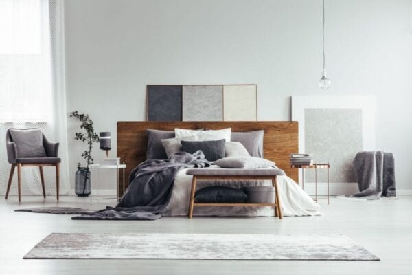 Small modern bedroom and bed with slim modern headboard