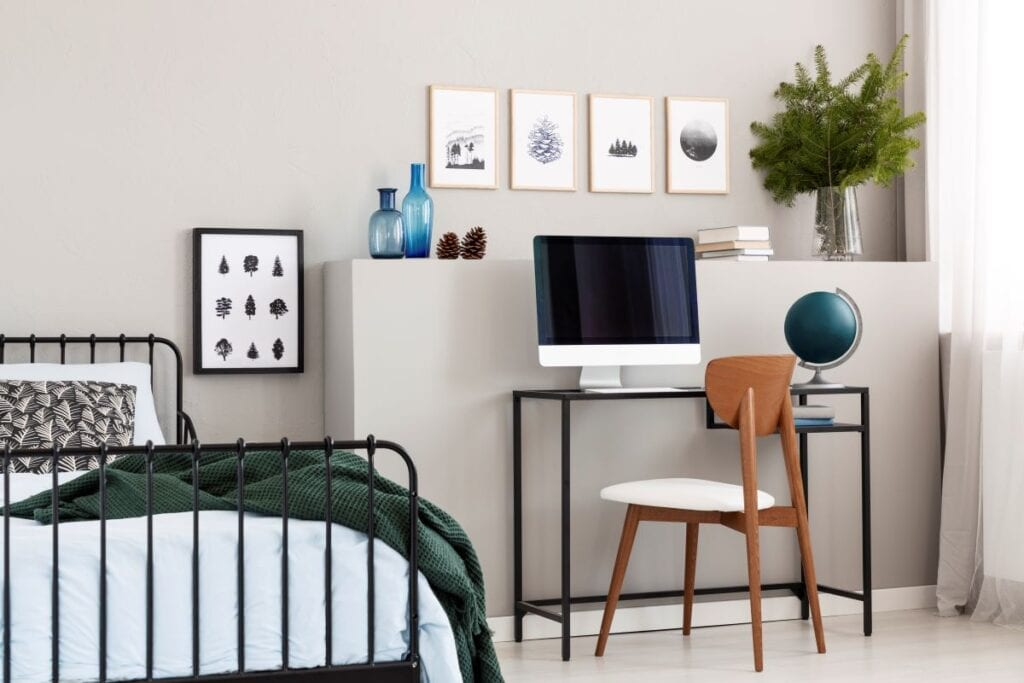 Bedroom with workspace and small wall art