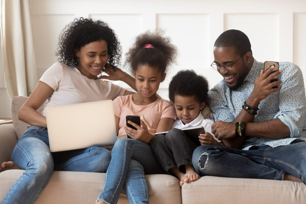family connected to internet on laptops and smart phones