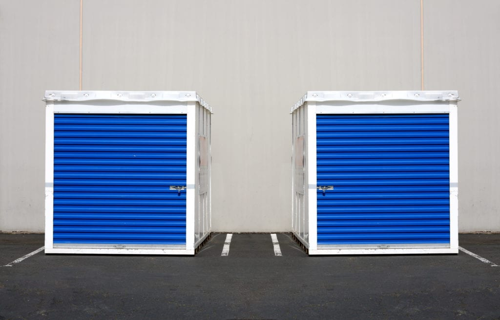Two storage pods in parking lot