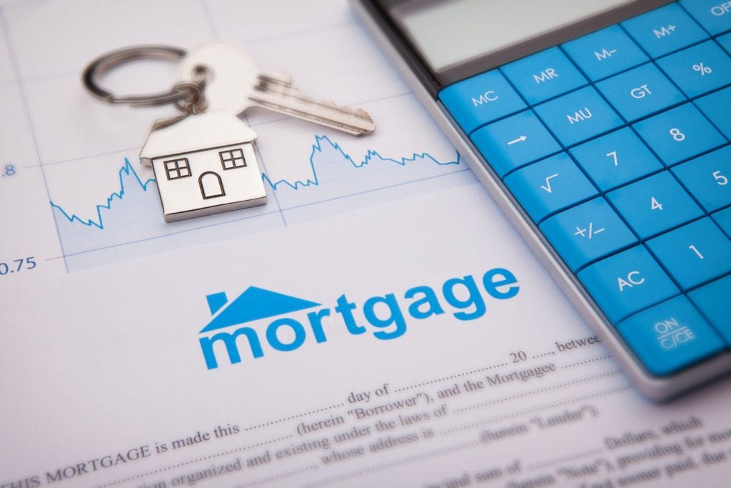 mortgage application with blue calculator and house key