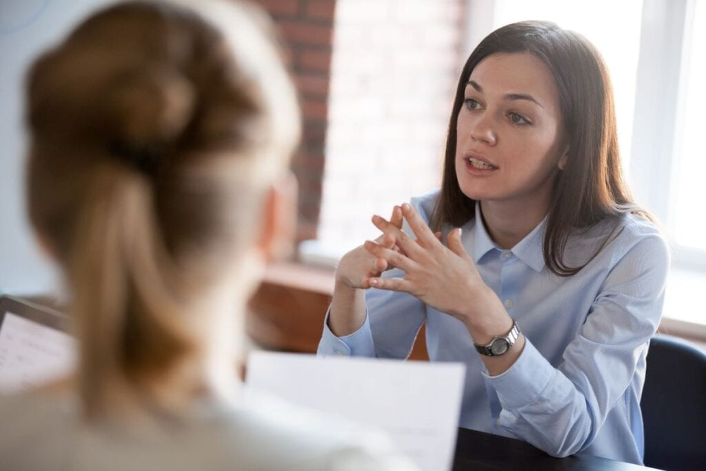 Two women negotiating
