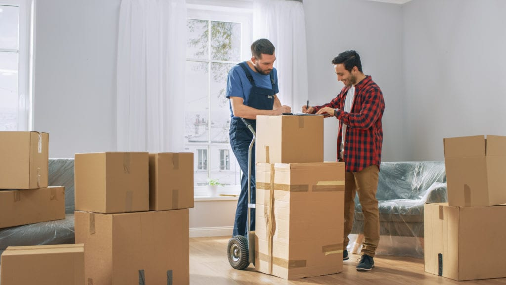 Man signs contract with professional mover to help carry boxes