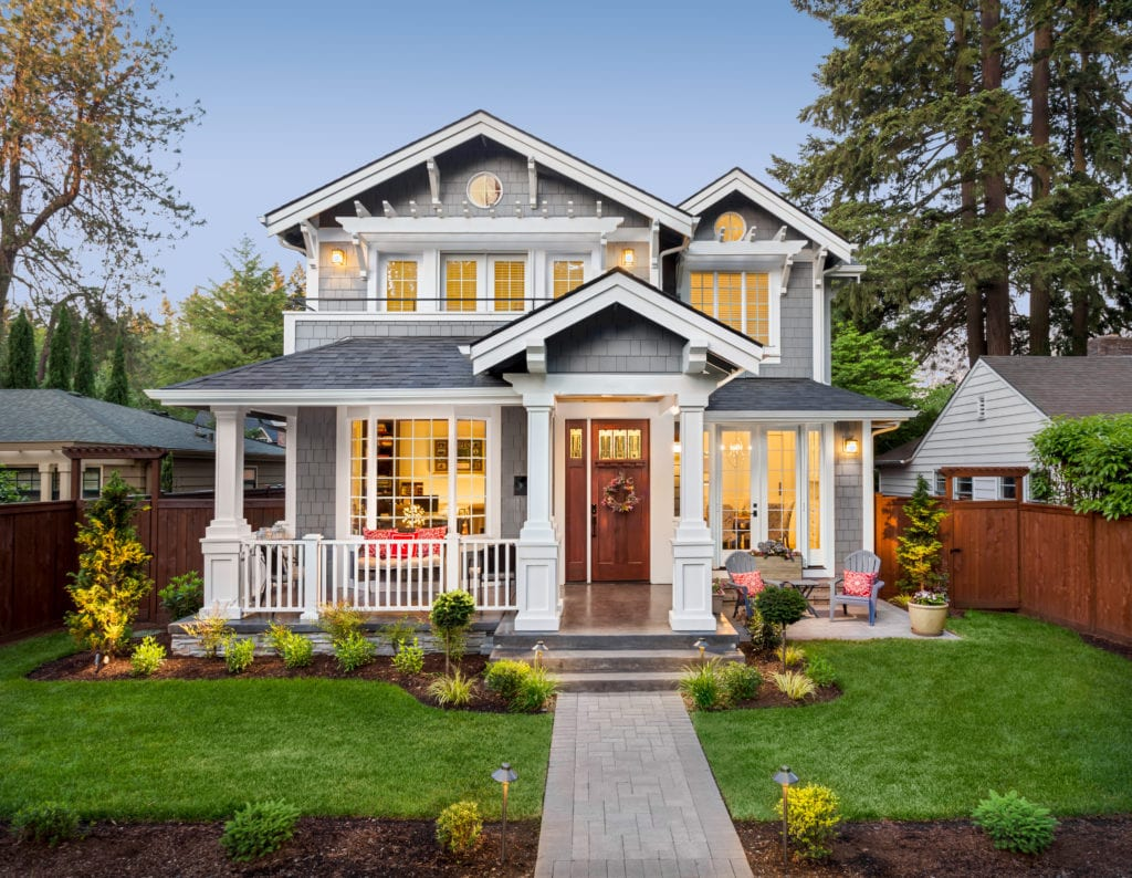 Gray house with well-kept lawn and landscaping