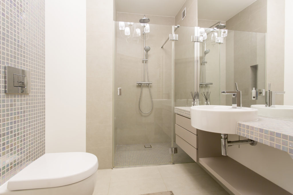 Bathroom with beige walls and cabinets