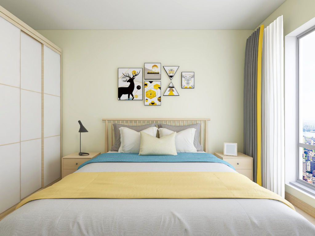 Light yellow bedroom with yellow and blue accents