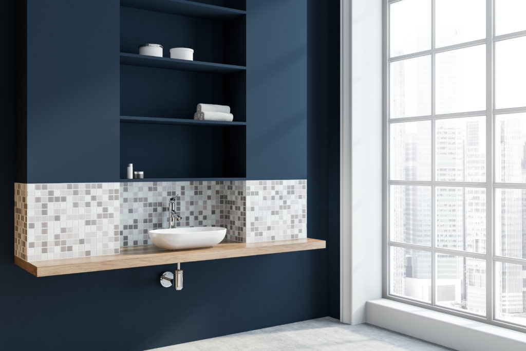 Navy blue bathroom with floor to ceiling windows