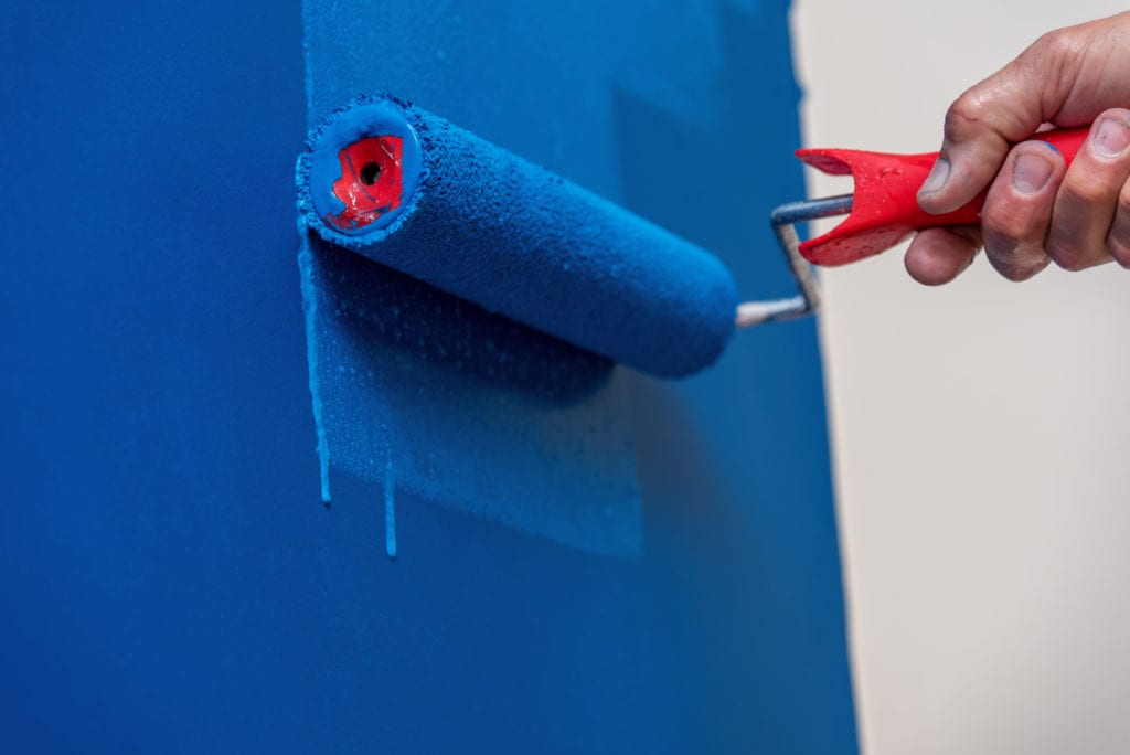 Decorator painting wall blue