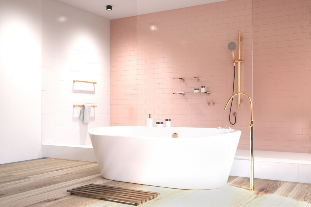Luxury bathroom with white tub and pink shower tiles