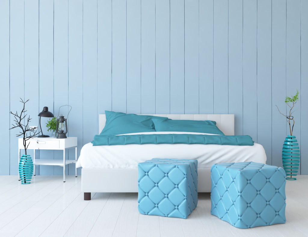 Light blue bedroom with light blue ottomans