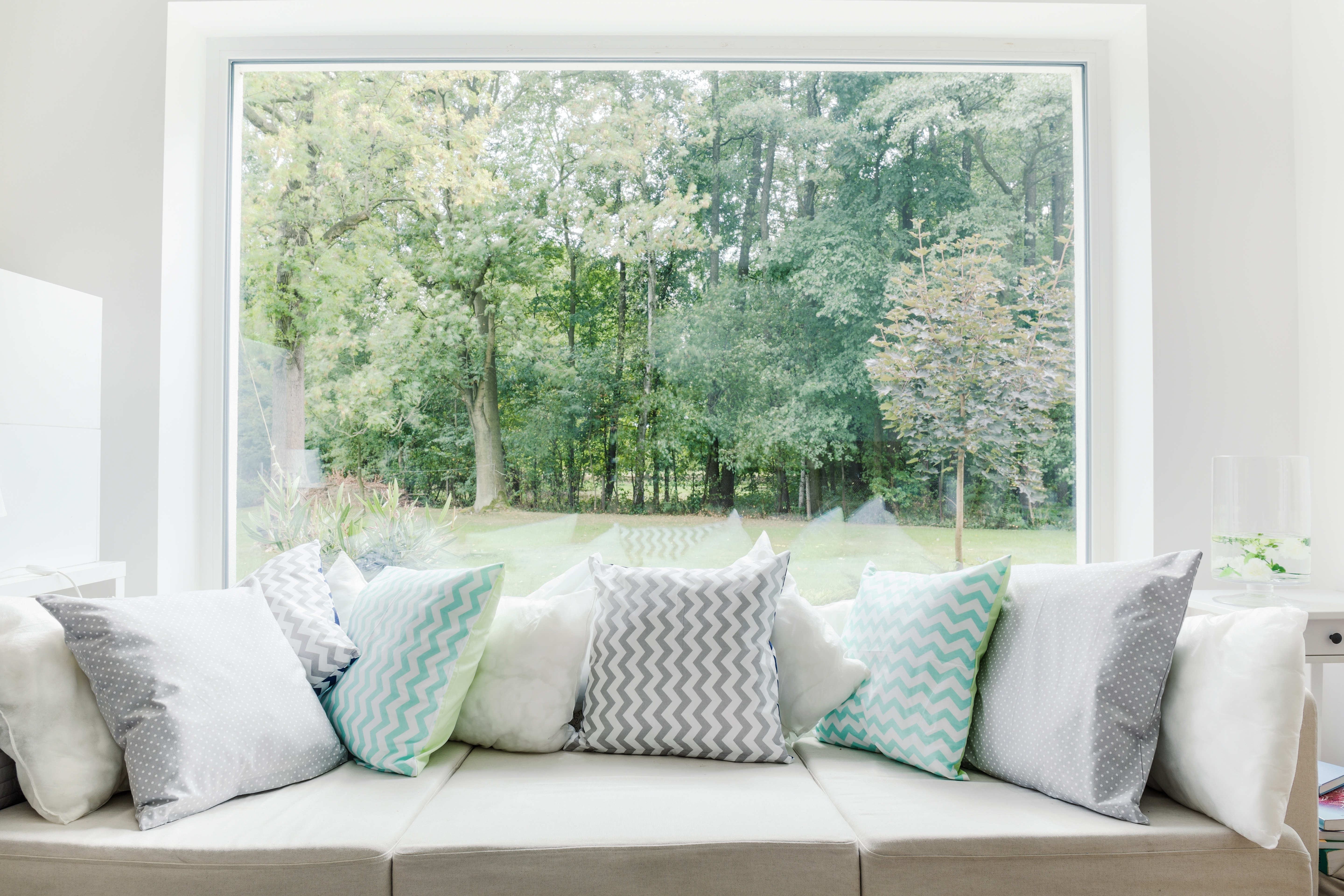 Image of relax area with large sofa and window