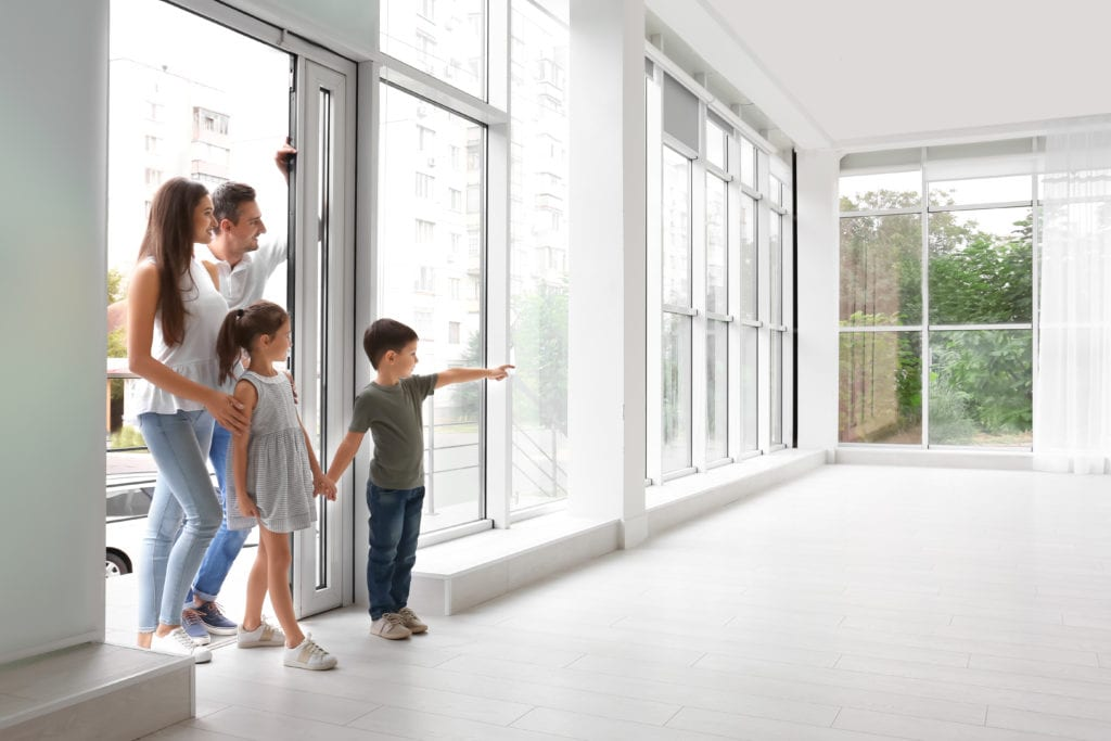 Family walking into new empty house
