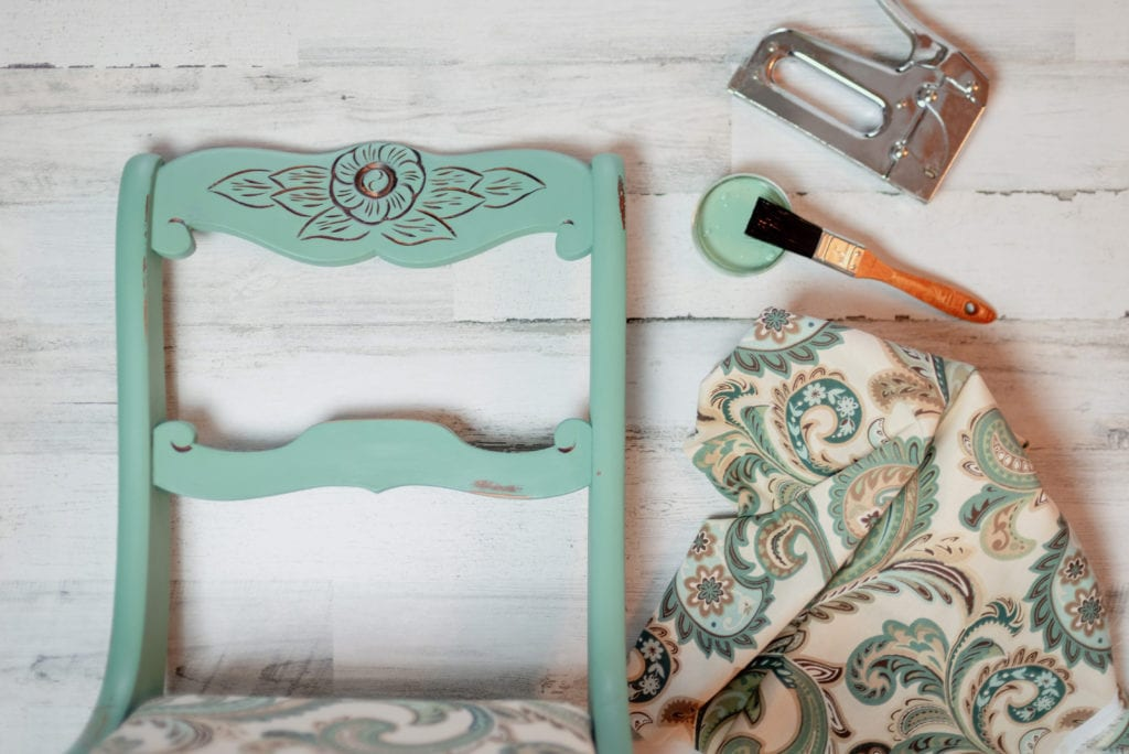 A vintage chair gets a makeover with a coat of teal chalk paint