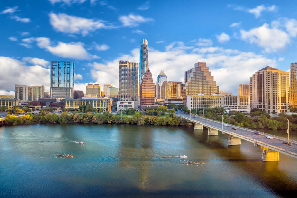 Austin, texas skyline with bright blue sky and clouds